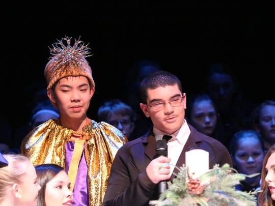 Thomas Dong and Elijah Price look over the Christmas table at the end of the play.