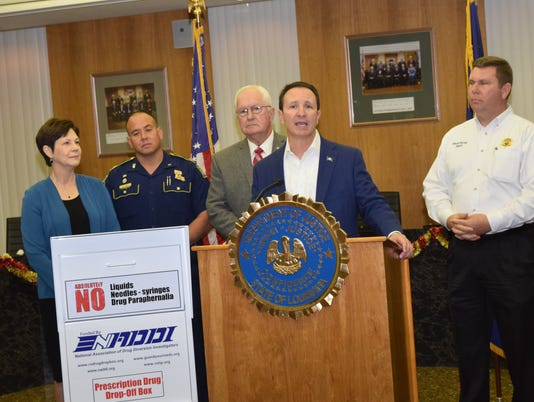 Dr. Diedre Barfield (left), senior medical director for Blue Cross Blue Shield; J.A. Smith, La. State Police captain; William Earl Hilton, Rapides Parish sheriff  and Steven McCain (far right), Grant Parish sheriff join Jeff Landry, Louisiana state attorney general (second from right) in announcing that a take back box will be placed at the Rapides Parish Sheriff's Office. The box allows residents a location to dispense of unused or expired prescription drugs.