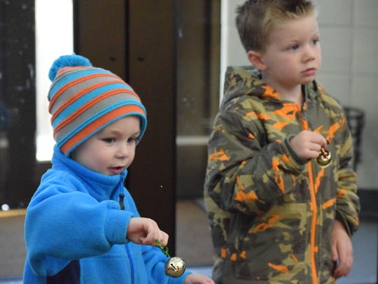 Nash Duncan and Max Gough ring their jingle bells while