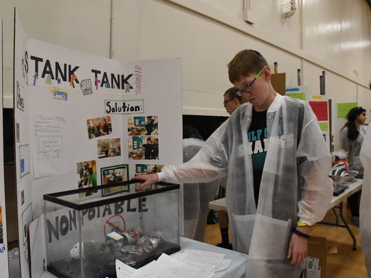 Johnathon Bingham, from Gulf Coast High, presents his group's experiment on water pollution on Dec. 8, 2017. A total of 196  students presented 71 projects in the 5th annual UNIQUE Science Fair. Lely, Naples, Palmetto Ridge, Barron Collier, Gulf Coast, Immokalee and Golden Gate High Schools showed their best work from students with special needs.