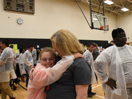A tender moment between a Lely High teacher and a student  during the 5th annual UNIQUE Science Fair at Lely High School on Dec. 8, 2017. Lely, Naples, Palmetto Ridge, Gulf Coast, Barron Collier, Immokalee and Golden Gate High Schools showed their best work from students with special needs.