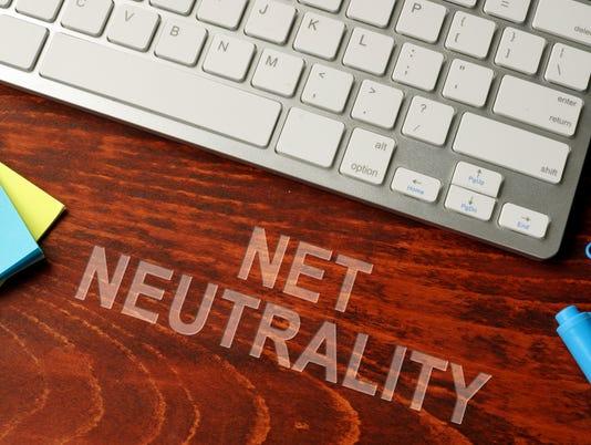 Net neutrality written on a wooden surface. Neutral internet concept.