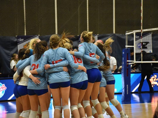 Florida Southern volleyball players celebrate after beating Gannon University in five sets Friday to advance to the NCAA Division II national championship game at the UWF Field House.
