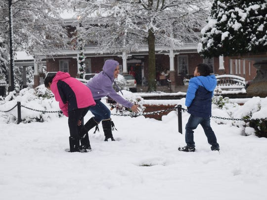 The Figueroa family enjoyed a snow fight in Georgetown on Saturday morning.