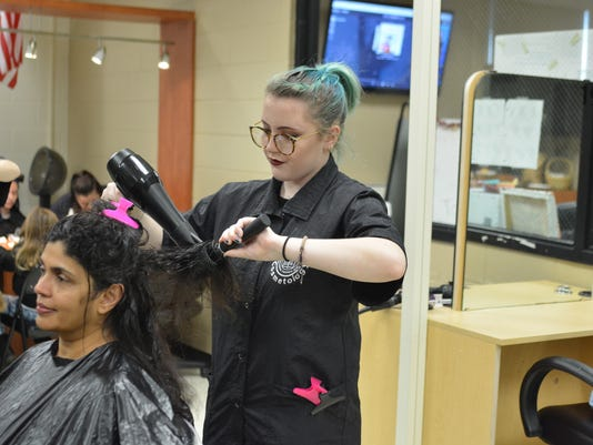 Cut-A-Thon & Toy Drive generates donations PHOTO CAPTION