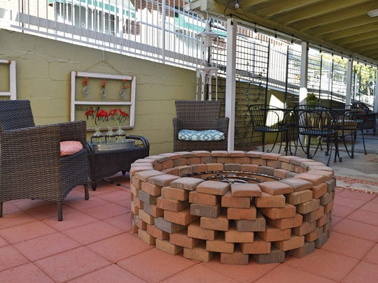 A custom-made brick fireplace for outdoor gatherings.
