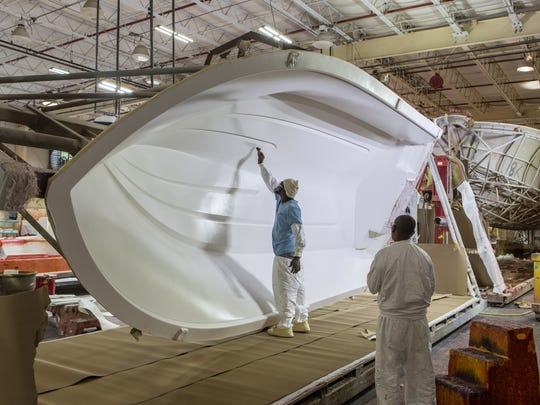 A Pursuit Boat employee paints a boat inside the new $2.1 million expansion project in Fort Pierce.
