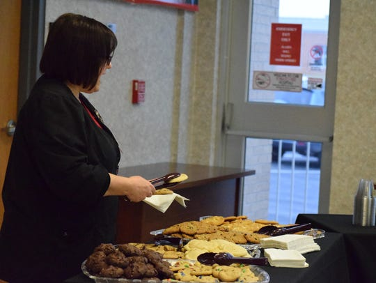 Christy Gough enjoys a Christmas cookie during the
