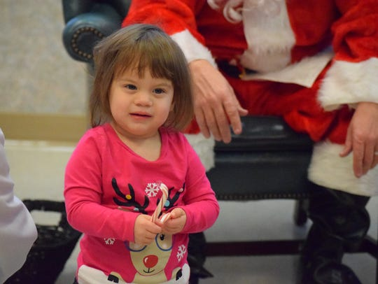 Emma Creighton smiles after her visit with Santa.