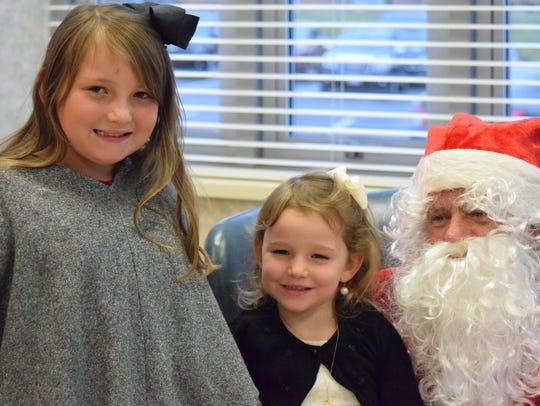 Malayna and Jayla Johnson pose for a picture with Santa.