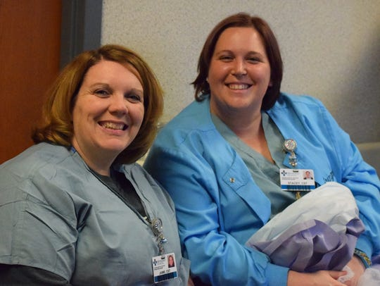 Jaime Doane and Stacey Parrish smile for a picture