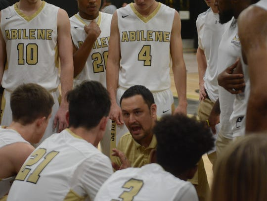 Abilene High coach Don Heseman talks to his team during