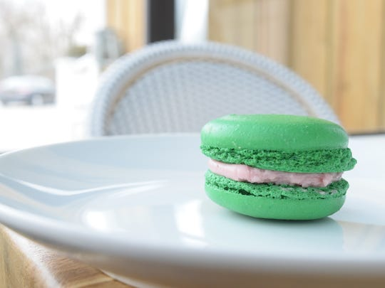 Patrons can sink their teeth into a hardy macaron. This one is flavored with bright raspberry.