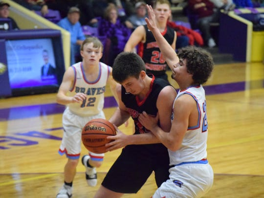 Lincoln Sisk works to stop his Edwards County opponent.