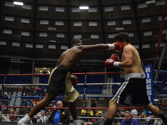 Jerrico Walton and Isai Montreal face off in a boxing match that was part of the Friday Night Championship Boxing held at the Rapides Parish Coliseum Friday, Dec. 29, 2017.