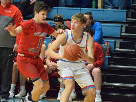 Cade Duncan looks to pass Tuesday night.