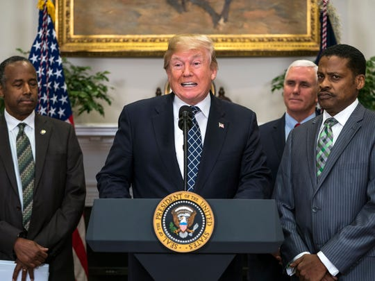 """President Donald J. Trump (C), alongside president for the Martin Luther King, Jr. Center Isaac Newton Farris, Jr.(R) and Secretary of Housing and Urban Development Ben Carson (L), speaks before signing a proclamation to honor Dr. Martin Luther King, Jr. Day in the Roosevelt Room of the White House. The President did not respond to shouted questions about whether he is a racist, in response to his referring to Haiti and African nations as """"shithole countries."""""""