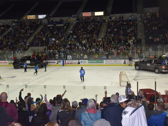 The Ice Flyers Mardi Gras Night included parades and bead throws at each intermission.