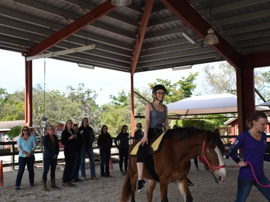 Hannah Wild, Naples Therapeutic Riding Center's program director, rides Clyde on Jan. 19, 2018. The two show therapists visiting the center during a four-day course on hippotherapy how to match a patient with a horse for therapy. Naples Therapeutic Riding Center recently underwent a $4 million capital expansion to add more courses, including this Hippotherapy Treatment Principles certification training course.