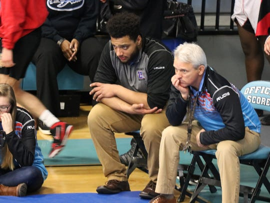 Coaches Reshawd Wilkins and Robert Ervin watch the matches during the duals tournament.