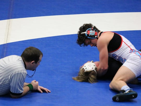 Micah Ervin pins his opponent during the tournament. Ervin went undefeated at the duals.