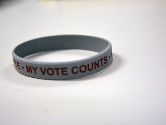 One of the bracelets being handed out to homeless voters to remind them of their voting rights.