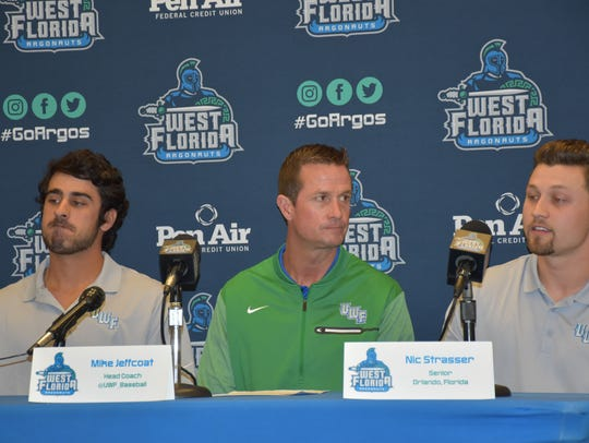 UWF baseball coach Mike Jeffcoat (center) discusses