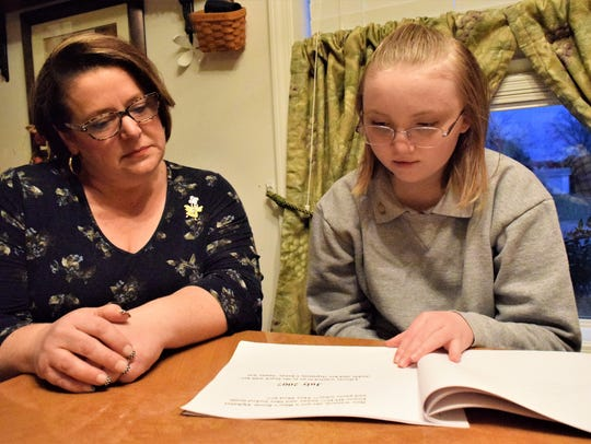 Jennifer Cinnelli Miller helps her 13-year-old daughter,