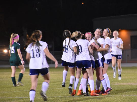 The Gulf Breeze girls soccer team celebrates its District 1-3A championship Friday after 4-3 win against Choctaw