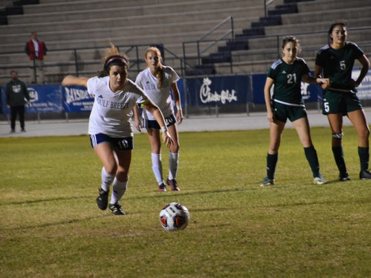 Gulf Breeze senior Rainey Niles prepares to take game-winning penatly kick goal that lifted Dolphins to 4-3 win against Choctaw to win District 1-3A Tournament championship