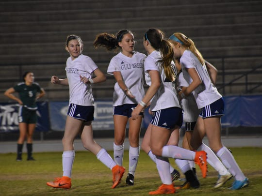Gulf Breeze players celebrate a goal during 4-3 win against Choctaw for district tournament championship