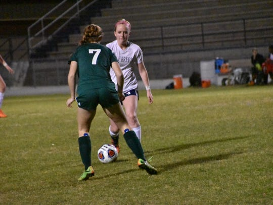 Gulf Breeze junior Katie Player, who scored a goal in the game,  gets past Choctaw defender during Dolphins 4-3 win in District 1-3A tournament championship