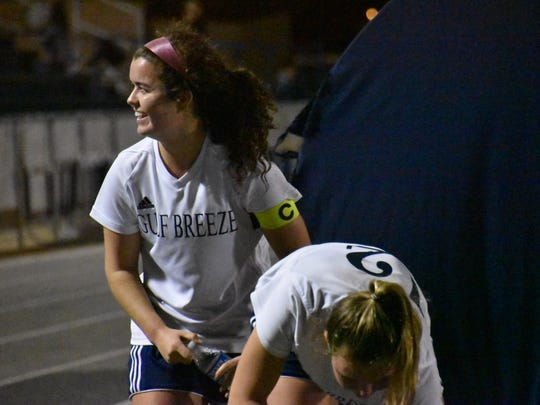 Gulf Breeze senior Rainey Niles acknowledges supporter in the stands Friday night during Dolphins 4-3 win against Choctaw in District 1-3A Tournament championship.