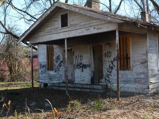 """One of many abandoned structures in west Jackson is littered with """"No Trespassing"""" notices."""