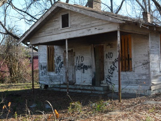 "One of many abandoned structures in west Jackson is littered with ""No Trespassing"" notices."