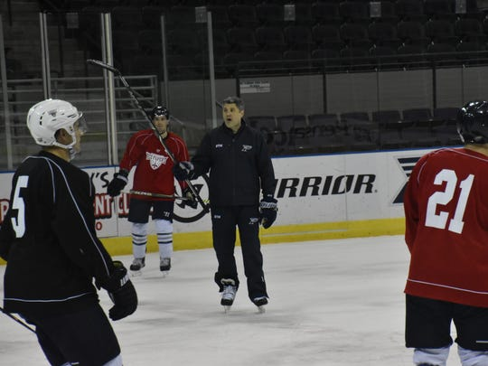 Ice Flyers coach Jeff Bes instructs team during practice Wednesday at the Pensacola Bay Center. The Ice Flyers have a pair of home games this weekend against Evansville (Ind.) Thunderbolts.
