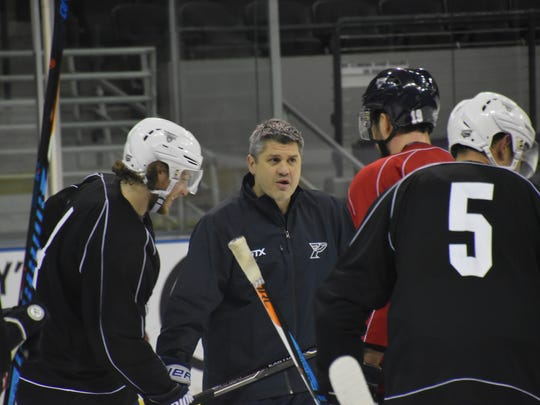 Ice Flyers coach Jeff Bes instructs players during workout Wednesday at Bay Center.