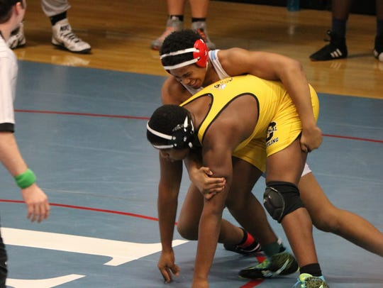 Elijah Calloway works to bring his opponent to the floor at the JV State Tournament.