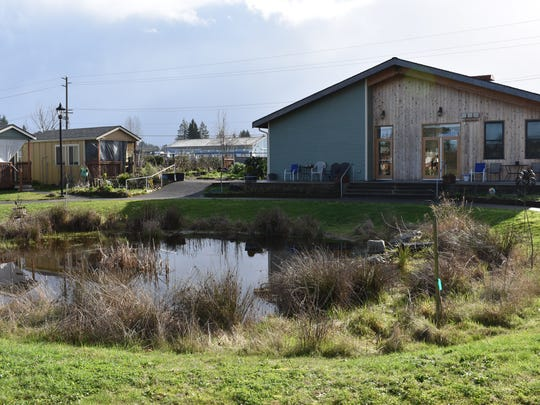 The community building and community garden, to the