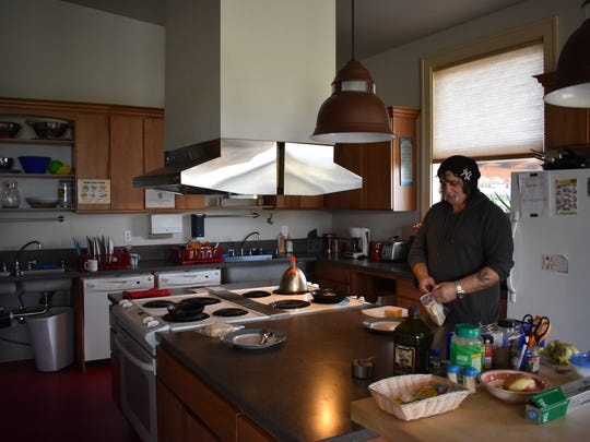 Tony Mesa makes lunch in the community building at