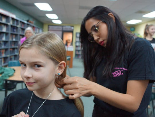 Third-grader and second-time donor Kailin McEnery gets