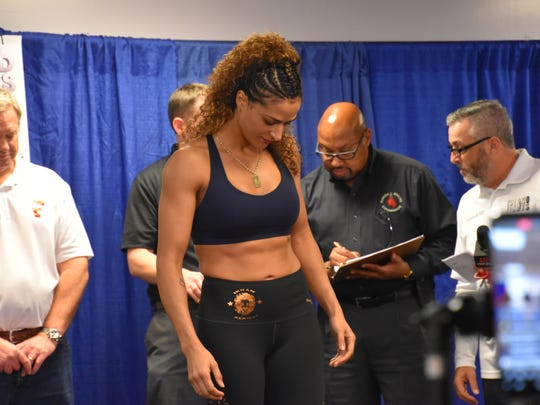 Ikram Kerwat, who is being trained by Roy Jones Jr., weighs in for her boxing title bout in Island Fights 46 Thursday at the Bay Center.