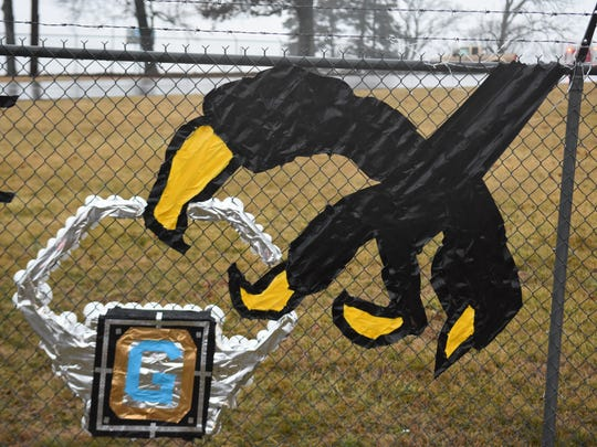 Gibbs Eagles fans decorated the fence at the entrance