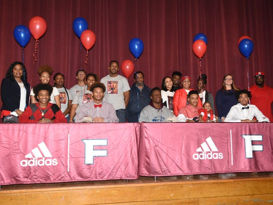 Fulton High School football players (seated) Joey Smith,