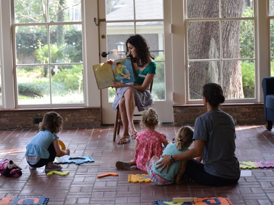 Mary Margaret Fernandez leads a storytime at The Grove.