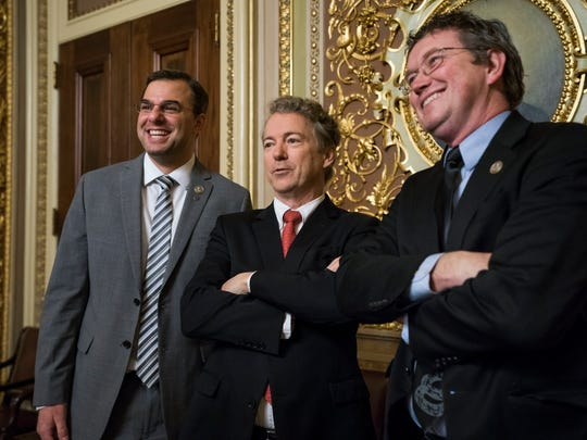 Republican Senator from Kentucky Rand Paul (center) poses for a picture with Republican Representative from Kentucky Thomas Massie (right) and Republican Representative from Michigan Justin Amash (left) as budget negotiations continue in the U.S. Capitol