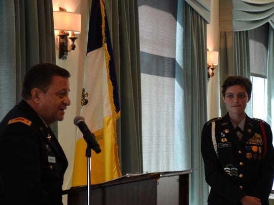 JROTC instructor Ruben Gonzales introduces his cadet,   Christine O'Brien with Barron Collier High before she reads an essay about JROTC during an event honoring seven outstanding JROTC students at a Sons of the American Revolution Naples chapter meeting on Feb. 8, 2018. O'Brien was one of three cadets who read essays to qualify as the outstanding cadet.