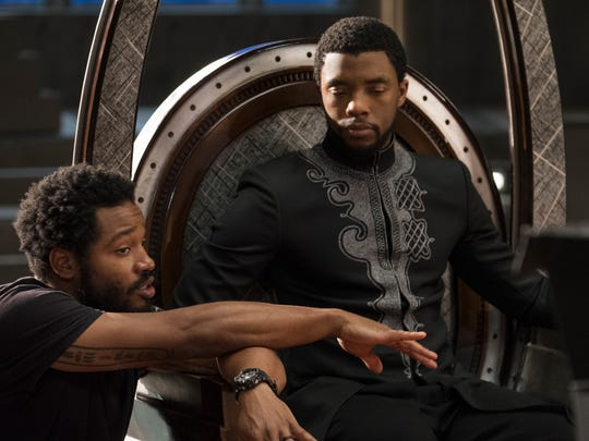 "Director Ryan Coogler (left) on the ""Black Panther"" set with Chadwick Boseman."