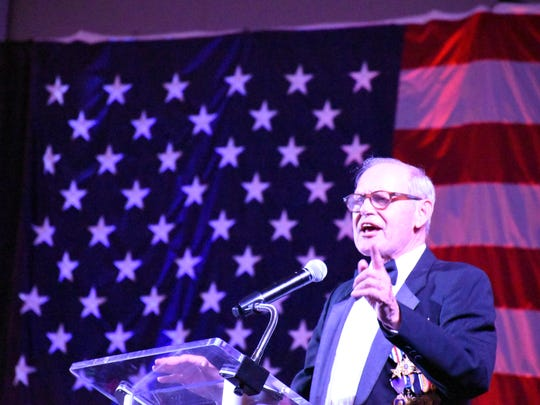 Cpt. Wayne Smith, who was held prisoner during the Vietnam War for five years, speaks during the 2018 Butterfly Ball hosted by Avow Hospice on Feb. 10, 2018 at Naples Municipal Airport.