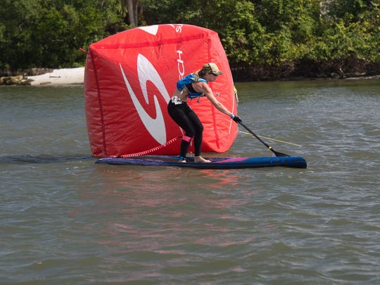 Maryanne Boier places first in the 12-foot, 6-inch SUP Female Division with a time of 00:25-36:80.